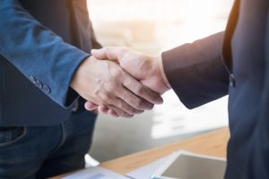 two-confident-business-man-shaking-hands-during-meeting-office-success-dealing-greeting-partner-concept_1423-185